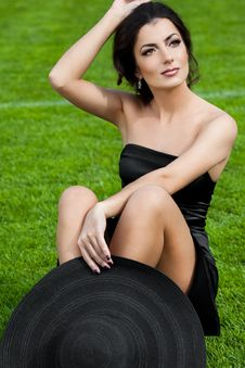 Free Woman Sitting On The Grass Stock Photos - 16579673