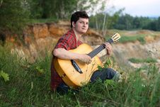 Free A Young Man With A Guitar Royalty Free Stock Images - 16579839