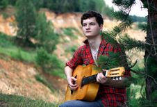 Free A Man With A Guitar Stock Photography - 16579892