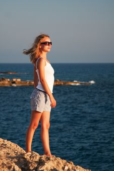 Free Woman Standing On A Rock Stock Images - 16580424