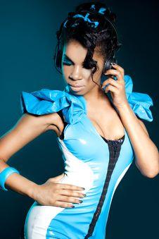 Mulatto Girl DJ Listens Music Royalty Free Stock Photo