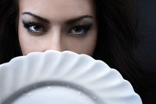 Glamour Woman With A White Porcelain Plate Royalty Free Stock Images