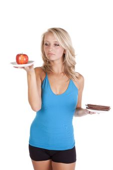 Free Blue Top Looking At Apple Pouty Stock Photography - 16583712