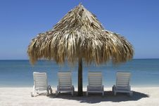Free Four Chairs And Palapa Stock Photo - 16584580