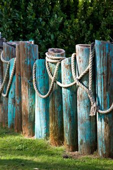 Large Rope Draped Over A Fence Stock Photo