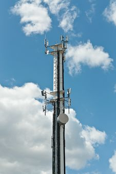 White Antenna Tower With Blue Sky And Clouds Stock Image