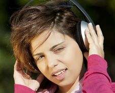 Free Pretty Young Girl Listening Music Royalty Free Stock Image - 16587466