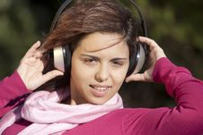 Free Pretty Young Girl Listening Music Stock Image - 16587471