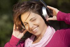 Free Pretty Young Girl Listening Music Stock Photo - 16587480