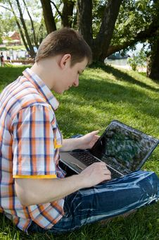 Free Young Man Using Laptop In Summer Park Stock Images - 16592194