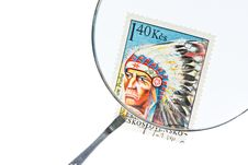Free Postage Stamp Under Magnifier With Tweezers Royalty Free Stock Photography - 16598547