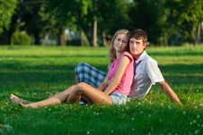 Free Two Young Lovers Sitting On Royalty Free Stock Photo - 16599415