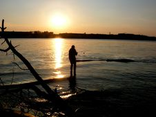 Free Man Fishing At Sunset River Royalty Free Stock Photos - 1667318