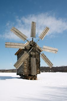 Windmill On Snow Plain Stock Photography