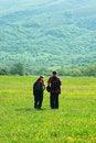Free Tourists In Mountain Meadow Royalty Free Stock Photos - 16603858