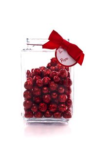 Candy Jar With Red Glittery Candy, And Gift Tag Royalty Free Stock Photography