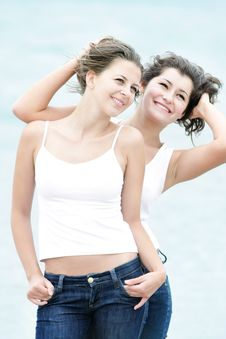 Young Happy Girls On Sea Background Stock Photos