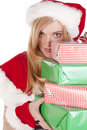 Free Mrs Santa Looking Around Stack Presents Stock Photos - 16613203