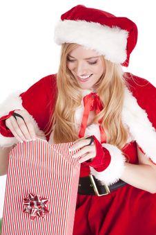 Free Mrs Santa Wraps A Gift Royalty Free Stock Image - 16613426