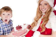 Woman Santa And Boy Surprised Gift Stock Photos