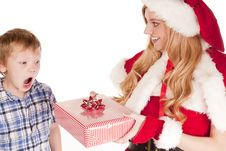 Young Boy Gift Mrs Santa Royalty Free Stock Photos