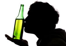 Man Kissing Bottle Of Beer Royalty Free Stock Photos