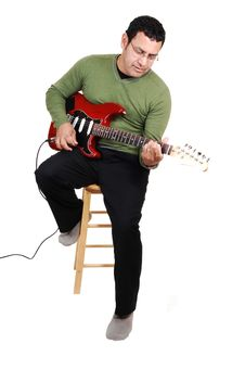 Free Man Sitting With Guitar. Royalty Free Stock Image - 16615406