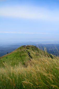 Hiker At Hill Of Grassland Stock Photography
