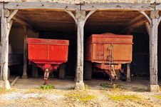 Trailers Parked In A Barn Stock Images