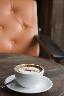 Free Cappuccino With Orange Armchair Background Stock Photo - 16618000