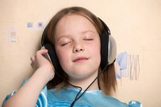Free Eight Year Old Girl Listening Music Royalty Free Stock Photography - 16618767