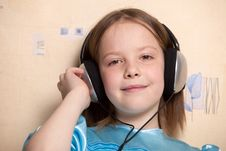 Free Eight Year Old Girl Listening Music Royalty Free Stock Photography - 16618787
