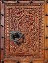 Free Relief Carved Wood With A Beautiful Metal Knocker Stock Photos - 16628183