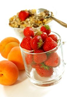 Strawberry In Glass And Muesli Isolated On White Royalty Free Stock Photos