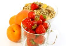 Strawberry In Glass And Muesli Isolated On White Stock Photos