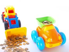 Toy Loader Loads The Coin Into The Truck Royalty Free Stock Image