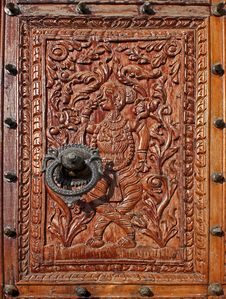Relief Carved Wood With A Beautiful Metal Knocker Stock Photos