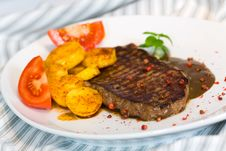Tasty Steak With Deep Fried Potato Royalty Free Stock Images