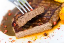 Tasty Steak With Deep Fried Potato Royalty Free Stock Image