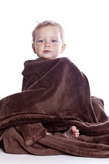 Beautiful Baby Under A Brown Towel Royalty Free Stock Photography