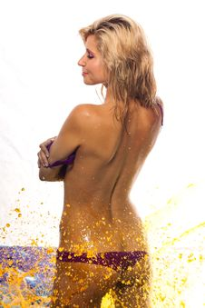Sexy Wet Girl In Fountain Of Yellow Water Stock Photography