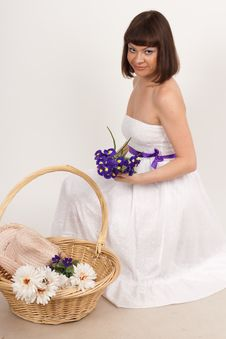 Free Beautiful Girl With Irises And A Basket Of Flowers Royalty Free Stock Images - 16631699