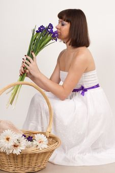 Free Beautiful Girl With Irises And A Basket Of Flowers Royalty Free Stock Photography - 16631707