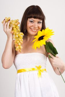 Free Girl With Grapes And Sunflower Royalty Free Stock Image - 16631776