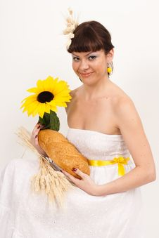 Free Girl With Bread, Sunflower And Ears Of Wheat Royalty Free Stock Image - 16631826