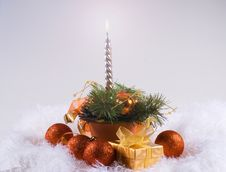 Christmas Orange Spheres And Silver Candles Stock Images