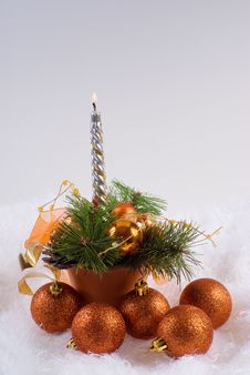 Christmas Orange Spheres And The Silver Candles Royalty Free Stock Photo