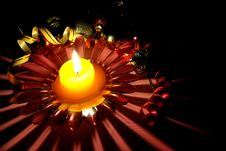 Candlestick With A Candle And Adornments Royalty Free Stock Photos