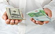 Free Man With Euro And Dollars Royalty Free Stock Image - 16637196