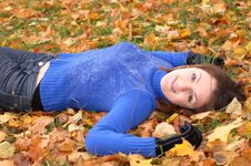 Free Woman Lying On The Autumn Leaves Stock Image - 16638131